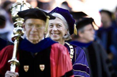 Professor of Sociology Sawyer Sylvester, the college's ceremonial mace-bearer, and President Elaine Tuttle Hansen