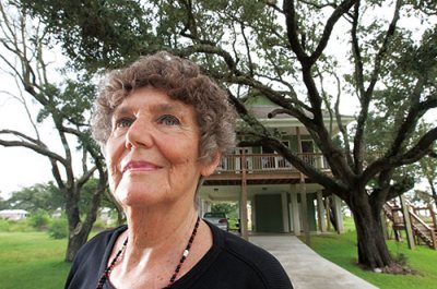 Janet C. Millard '54 of Long Beach, Miss., poses by the beach and at her home at 419 Gulf View Ave. She rebuilt the home after it was destroyed by Hurricane Katrina in 2005. Millard said that her love for the live oak trees on her property and the water adjacent to it were two of the major reasons she decided to rebuild.
