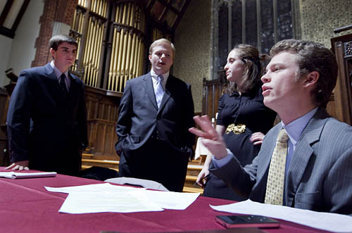 Yale debaters Josh Kalla and Grant May confer with Brooks Quimby seniors Ariela Silberstein and Matt Marienthal.