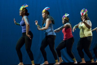 "Culminating the college's Jan. 17 observances of Martin Luther King Jr. Day, students used music, dance, poetry and prose to survey the vast landscape of the African Diaspora, and their own diverse backgrounds, in an evening performance in Schaeffer Theatre.Titled Sankofa, a term from Ghana's Akan language referring to the idea of going back for what you have forgotten, the show emphasized the importance of remembering the past in order to appreciate the present and improve the future.Ashley Booker '12Ashley Booker '12 of New York City performs during the Poetry Slam.Reflecting the concept ""Get Up, Stand Up: The Fierce Urgency of Now"" -- the theme for this year's MLK Day programming at Bates -- the performers captivated audience members with their talent, pride and intensity. Fellow students, faculty and townspeople including members of the local Somali community filled the theater. The production, the first of its kind, drew hoots and hollers, laughter and tears from the audience.The production featured emotional readings, striking dance and uplifting music, displaying the talents of students from myriad backgrounds and disciplines. Directed by Linda Kugblenu '13 of New York City and produced by Cynthia Alexandre-Brutus of Brooklyn, N.Y., the production was as much a lesson in history and culture as entertainment.In one piece, actresses Omosede Eholor of New York City and Brittney Davis of Chicago, both first-years, performed Alexandre-Brutus' adaption of Sojourner Truth's speech ""Ain't I A Woman?"" Rendered as a dialogue, the scene juxtaposed the inequalities facing black women in the 18th and 19th centuries with the modern context, a contrast heightened by stage lighting and costumes.In ""Four Blast From the Past,"" four performers portrayed liberation movement leaders from across Africa. Raina Jacques '13 portrayed Yaa AsanteWaa, queen mother of the Asante confederacy. She vehemently delivered the speech that stirred the men of the community to fight"
