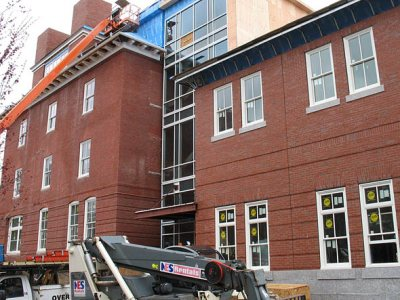 In color and detail, the recently finished brickwork on the addition to Roger Williams Hall, at right, resembles the walls on the original structure. Photographed April 28, 2011.