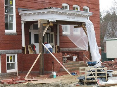 A mason works on the reconstruction of the historic porch on Roger Williams Hall on April 28, 2011.