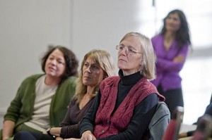 From left, Mary Rice-DeFosse, Francisca López, and Jane Costlow listen as Rhea Coté Robbins reads one of her poems.