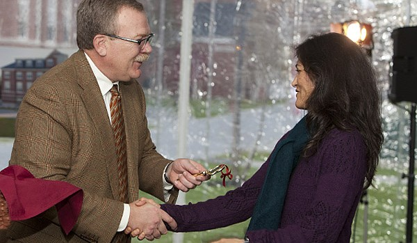 Board chair Mike Bonney '80 presents a symbolic key to Roger Williams Hall to Spanish professor Claudia Aburto Guzmán during dedication festivities for Roger Williams and Hedge halls. Photograph by Rene Minnis.