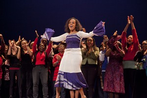 Sankofa director Bethel Kifle '14 acknowledges appreciation from the Schaeffer Theatre audience and production's cast at the end of the 2012 Sankofa performance.