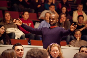 Marc Bamuthi Joseph engages with his audience in the aisles of the Olin Arts Center Concert Hall. (Photographs by Phyllis Graber Jensen)