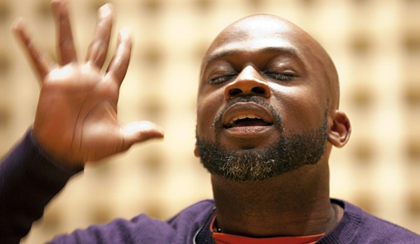 "Shown performing at Bates in January, Marc Bamuthi Joseph brings his dance and spoken-word piece ""red, black & GREEN: a blues"" to Bates in April. Photograph by Phyllis Graber Jensen/Bates College."