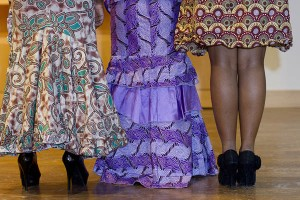Modeling Nigerian dresses for the Inside Africa Fashion Show are sophomores Folarera Fasawe, Michelle Pham and Nicole Kanu.