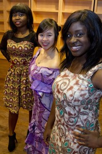 Modeling Nigerian dresses for the Inside Africa Fashion Show are first-year students (from left) Folarera Fasawe, Michelle Pham and fashion show host Nicole Kanu.