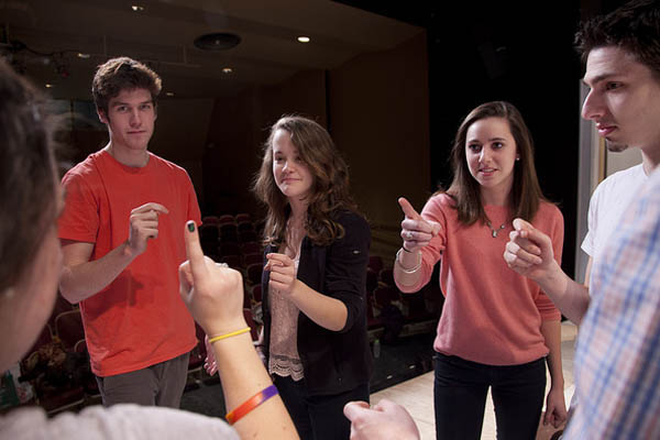 "Right to left: Daniel Waters '12, director Elizabeth Castellano '12,  Hanna Allerton '15, Charles McKitrick '14 and Caitlyn Defiore '12 (back to camera) rehearse for ""A Doll's House."""