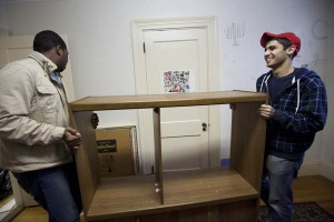 This October 2010 image shows Mikey Pasek '12, right, with Jourdan Fanning '13, left moving furniture in the Office of Intercultural Education, a location that includes space for Bates Hillel. Photograph by Phyllis Graber Jensen/Bates College.