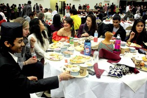 Happy diners think globally and eat locally at the 2012 International Dinner, held March 3 in the Gray Athletic Building. Photograph by Simone Schriger '14.
