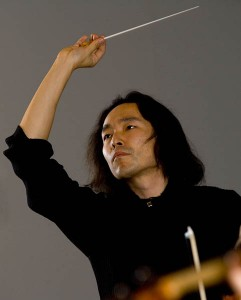 Hiroya Miura conducts the Bates College Orchestra.