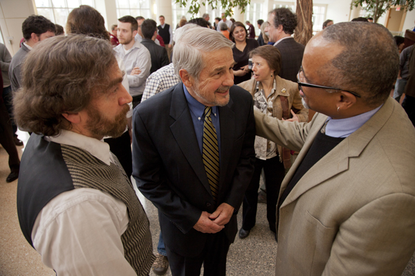 Former Bates President Don Harward chats with Glen Lawson (left) and Marcus Bruce, during a reception for them and others recently appointed to named professorships.