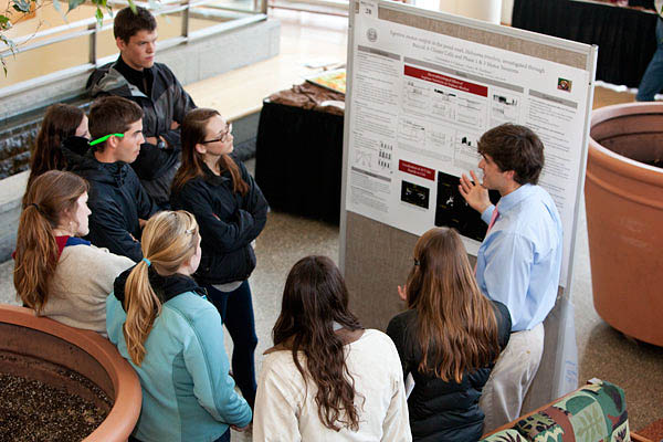 Christopher Calahan '12 describes his neuroscience research based on pond snails. Photograph by Rene Minnis.