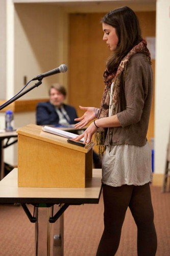 With poet and writing adviser Rob Farnsworth looking on, Karen Nicoletti '12 reads from her novel during the 2012 Mount David Summit. Photograph by Rene Minnis.