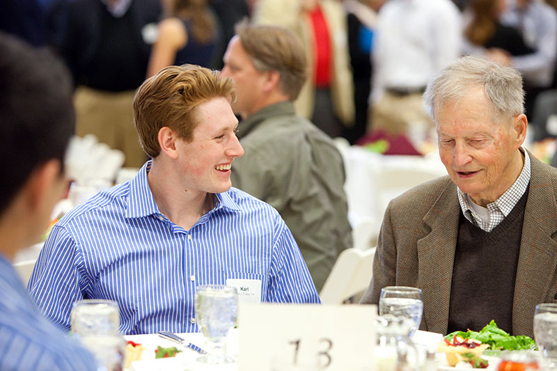 Karl Fisher '14, left, talks with Charles E. Clark '51 at the Mount David Society Scholarship Luncheon on March 30. Clark is the author of Bates Through the Years: An Illustrated History, as part of the college's sesquicentennial.