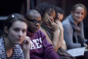 Shown listening to Marc Bamuthi Joseph in April are, from left, Katie Straw '12, Yasin Fairley '12, Ashley Booker '12, dance professor Rachel Boggia and theater lecturer Kati Vecsey. Photograph by Phyllis Graber Jensen/Bates College.