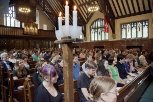 Gathered students, staff, and faculty fill the College Chapel pews during a memorial service for Evan Dube  '15.