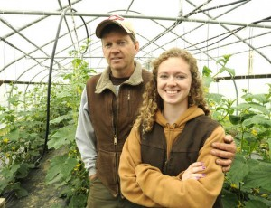 Tomi Chipman '14 stands with her father, Doug, in one of their greenhouses in Poland. Photograph by Jose Leiva/Sun Journal.