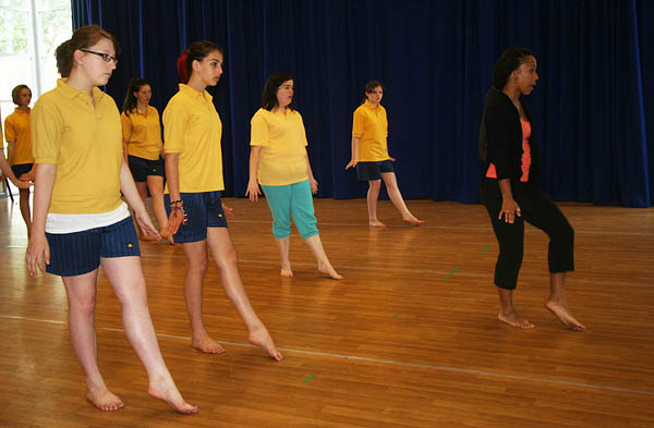 Victoria Lowe '12, at right, leads a dance class during her 2012 internship at the Tacchi-Morris Arts Centre in Taunton, U.K.