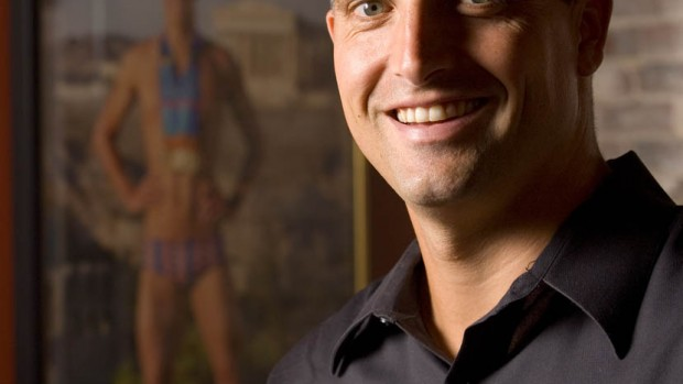 From 2007, this portrait of Peter Carlisle '91 was taken in his Portland, Maine, office. The poster behind Carlisle shows Michael Phelps wearing his Olympic medals in Athens. Photograph by Phyllis Graber Jensen / Bates College.