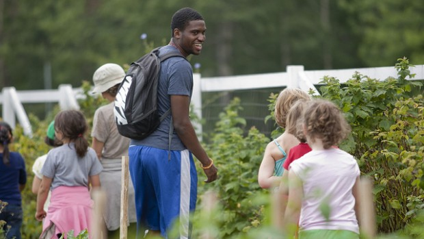 Among the Harward Center's initiatives is the Community-Based Research program, which allows students to connect service and academics. Above, David Longdon '13 helps lead youth programming with Lots to Gardens, a community garden program in Lewiston. Photograph by Phyllis Graber Jensen/Bates College