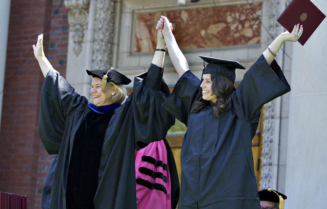 With characteristic charm and sense of the moment, interim President Nancy Cable salutes Hannah Zweifler, the final graduate to receive her diploma at Commencement 2012. Photograph by Phyllis Graber Jensen / Bates College.