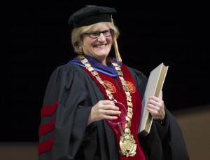 Clayton Spencer holds the symbols of office during her installation ceremony as the eighth president of Bates College. The symbols are the keys, the presidential collar and the record book.