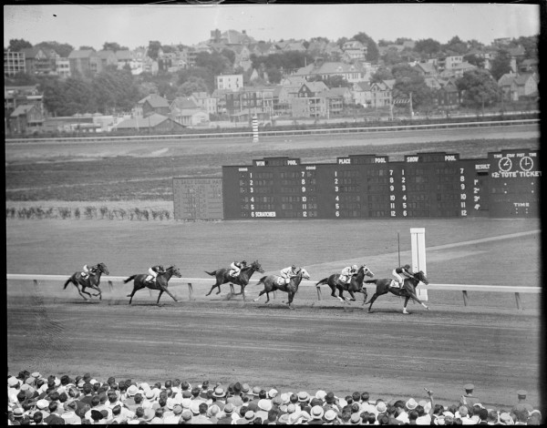 "Bookies and other gamblers used to depend on skilled ""line men,"" like Uncle Arthur, for timely sports results, including race results from Suffolk Downs in East Boston, shown here in the 1930s. Photograph courtesy of the Boston Public Library, Leslie Jones Collection."