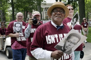 The Rev. Peter Gomes '65 is shown with members of his class during the Reunion parade in 2005. Photograph by Phyllis Graber Jensen/Bates College.