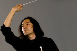 Hiroya Miura conducts the Bates College Orchestra. Photograph: Phyllis Graber Jensen/Bates College.