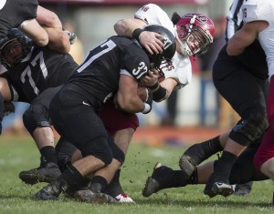 Josh Chronopoulos '13 brings down the Bowdoin ballcarrier during a 14-6 Bates victory in Brunswick on November 3, 2012.