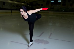 "A participant as well as scholar of culture, Rand often injects personal experiences into her work. Here, skating in Falmouth, she bends back her leg for a catch-foot spiral, an ""age-defying"" move she describes in Red Nails, Black Skates. Photograph by Mike Bradley/Bates College."