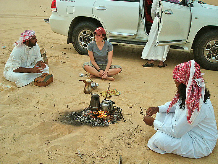 Anthropology major Devin Tatro '14 talks with Saudi men at a desert farm in the Eastern Province during a Short Term trip last spring to Saudi Arabia led by Dana Professor of Anthropology Loring Danforth. This was a rare moment in Saudi society: women talking with men publicly and allowed not to wear abayas. Photo: Ana Bisaillon '12.