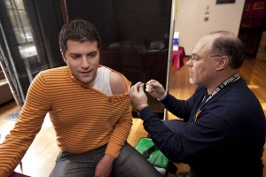 During a vaccine clinic in October 2009, Miljan Zecevic '10 receives his vaccine injection. Photograph by Phyllis Graber Jensen/Bates College.