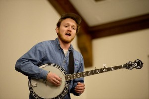 Grady Hogan '13 performed in Memorial Commons with Lena and Los Morose Bros. Photograph by Michael Brady/Bates College.