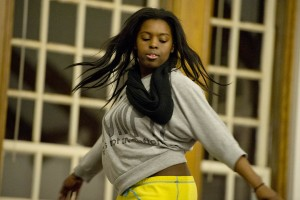 Dancer Tomisha Edwards '15 performs in Memorial Commons during Bates' 2013 Arts Crawl. Photograph by Michael Bradley/Bates College.