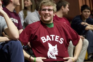 Bates student Tim Campbell sports his new Bobcat T-shirt at Satuday's Bates-Tufts men's basketball game. The new Bobcat was revealed at halftime of the game. Photo by Phyllis Graber Jensen/Bates College.