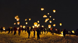 "The Bates Outing Club's ""Children of Midnight"" event on Jan. 29, 2013, culminates with the launch of sky lanterns above Mount David. Photograph by Will Strathmann '13."