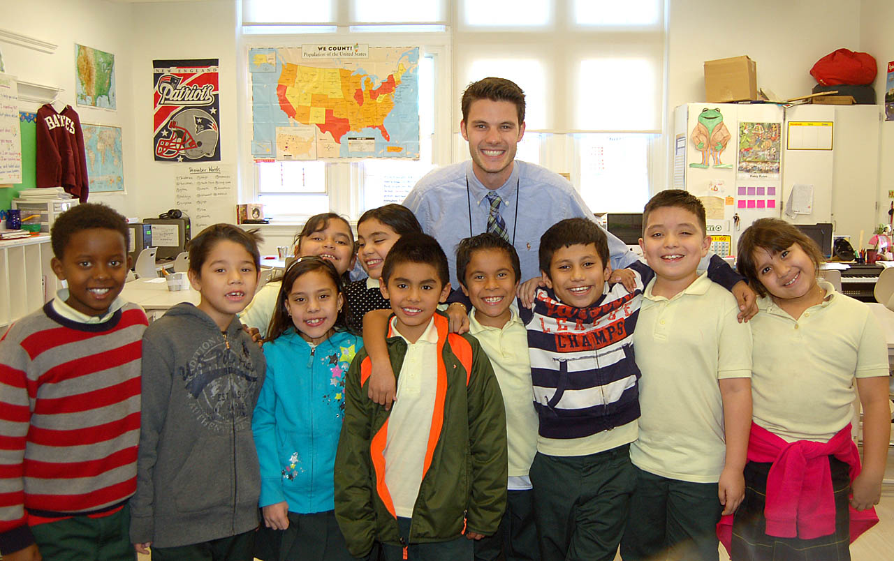 All smiles, Drew Gallagher '11 poses with a group of his students at Bruce-Monroe Elementary School in Washington, D.C. Photo courtesy of Drew Gallagher '11.
