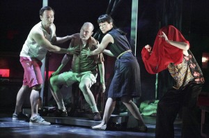 In this scene from the play Christmas in Hanoi, Joseph Kim '96 plays the son, Lou, at left.  