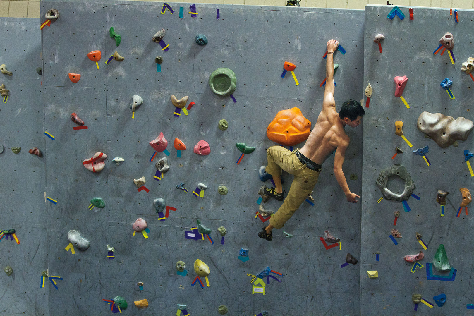 Chester Chiao '13 trains on the rock wall in Merill Gymnasium Photograph by Phyllis Graber Jensen/Bates College