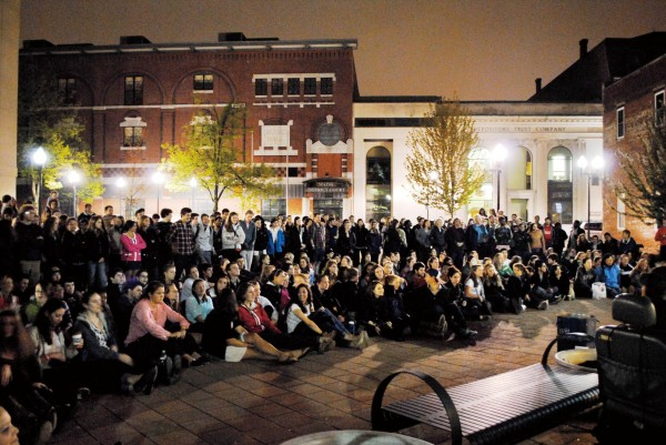 "Batesies and fellow Lewiston-Auburn college students gather at the Courthouse Plaza on Lisbon Street for an a cappella performance that concluded ""College Night in Town"" in May. Photograph by event co-organizer Mikey Pasek '12."