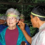Author and world traveler Dorothy Stetson Conlon '50 has her face painted by a shaman in the Amazon jungle of Ecuador in 2009.