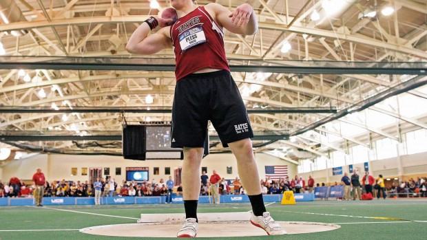 David Pless '13 prepares to throw the shot, en route to winning his second consecutive NCAA Division III indoor title in 2012 and breaking the NCAA Division III Indoor record by 9.5 inches. Photograph by Stephen Mally/NCAA.