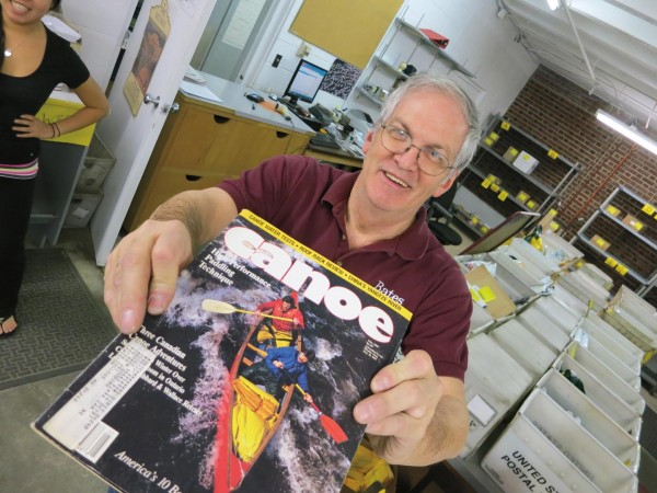 "Gregg ""Vinnie"" Vincent, Bates campus mail supervisor, shows off the May 1987 issue of Canoe magazine that arrived from the USPS at Bates on April 13, 2012."