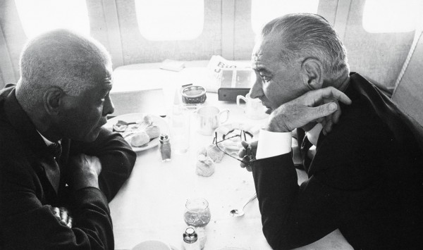 In June 1963, Mays and then-Vice President Lyndon Johnson confer while en route to the state funeral of Pope John XIII.  Yoichi Okamoto/LBJ Presidential Library