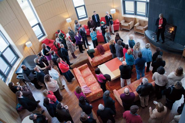 Bates staff and faculty gather in the Fireplace Lounge in New Commons to ask questions of and hear from their new leader. Photograph by Phyllis Graber Jensen/Bates College.