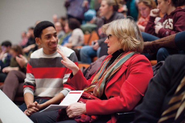 The president-elect makes tracks to get up to speed on Bates Sean McGhee '12 of Chicago, Ill., talks with Spencer in the Olin Arts Center Concert Hall, site of the annual debate between Morehouse and Bates on Martin Luther King Jr. Day. Photograph by Phyllis Graber Jensen/Bates College.